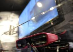 epa01981657 A view of 3D Goggles on display at the Sony Booth at the Consumer Electronics Show (CES) in Las Vegas, Nevada, USA. 06 January 2010. CES runs from 07 to 10 January.  EPA/ANDREW GOMBERT