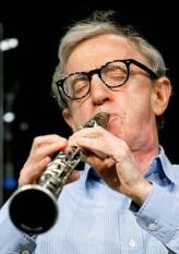 epa000243473 US film director and actor Woody Allan plays the clarinet as he performs with the New Orlean Jazz Band at the Tempodrom in Berlin, Germany, Sunday 01 August 2004. EPA/Soeren Stache