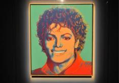 epa01816262 US artist Andy Warhol's painting of late US singer Michael Jackson is exhibited at East London's O2 Arena, Britian, 05 August 2009. Painted in 1984, it is shown to the public for only three days at the place of Michael Jackson's last major public appearance, the O2 Arena, before it returns to New York to be auctioned off with bids starting at ,000.  EPA/DANIEL DEME