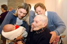 Nicolas Cristini, a boy born in the northern Italian village of Colorina, near Sondrio, is shown by his mother Simona Codega (L), 21, to the oldest relative, 101-year-old great-grandmother Ancilla Trutalli, on Tuesday 13 January 2004. The baby claimed the Italian record for the number of grandparents, great-grandparents and great-great-grandparents. Little Nicolas Cristini, with 13 of them, beat the previous record set by a Sicilian baby with 11 family elders. Ancilla Trutalli, burst into tears as she clutched the latest arrival. Nicolas©s first gifts were a pair of soccer boots and a ball. In a remarkable coincidence, shortly after Nicolas came into the world, a baby born in the Sicily©s city Caltanissetta tied the old record in bringing the number of generations in his family to five. Francesco Cereda can in fact boast an 80-year-old great-great-grandmother as well as six great-grandparents and four grandparents. EPA/CARLO ORLANDI
