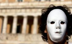 epa02150416 Athenians, wearing white masks, gather outside the Greek Parliament to protest against the government's austerity measures as well as the violence that erupted during the recent demonstrations, in Athens, Greece, 09 May 2010.  EPA/KATERINA MAVRONA