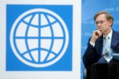 epa02648181 World Bank President Robert Zoellick is seen behind a podium displaying the logo of the World Bank, before signing a memorandum of understanding between the US government and the World Bank with US Secretary of State Hillary Clinton (not pictured), to strengthen support for developing countries seeking a water secure future, at the World Bank Headquarters in Washington DC, USA, 22 March 2011. World Water Day is marked annually on 22 March. The objective of WWD 2011 is to focus international attention on the impact of rapid urban population growth, industrialization and uncertainties caused by climate change, conflicts and natural disasters on urban water systems.  EPA/MICHAEL REYNOLDS