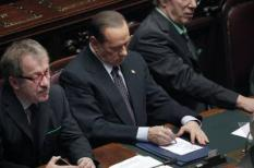 epa02996514 Italian Premier Silvio Berlusconi (C) takes notes during the speech of Pierluigi Bersani of Democratic Party, after a key vote on the country's 2010 accounts, Rome, Italy, 08 November 2011. Berlusconi's ruling centre-right coalition failed to gain an absolute majority in a key vote on the country's 2010 accounts, increasing the likelihood that the embattled prime minister may soon be forced to step down. The government received 308 votes in favour in the 630-seat lower house Chamber of Deputies. A further 321 lawmakers, including the opposition centre-left, did not take part in the vote.  EPA/GIUSEPPE LAMI