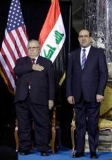 epa03021032 Iraqi Prime Minister Nouri al-Maliki (R) and Iraqi President Jalal Talabani (L) salute during the playing of the Iraqi and U.S. National Anthems during a special ceremony at Camp Victory, one of the last American bases in the country where the U.S. military footprint is swiftly shrinking, in Baghdad, Iraq, 01 December 2011. U.S. Vice President Joe Biden thanked U.S. and Iraqi troops for sacrifices that he said allowed for the end of the nearly nine-year-long war, even as attacks around the country killed 20 people, underscoring the security challenges Iraq still faces.  EPA/Khalid Mohammed/POOL