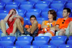 CHARKOV - Supporters van het Nederlands elftal balen na de nederlaag tegen Portugal tijdens de laatste groepswedstrijd van Oranje op het EK voetbal 2012. ANP KOEN VAN WEEL