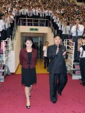 epa03331186 ALTERNATIVE CROP OF epa03331185 --  A photo released by the North Korean Central News Agency (KCNA) on 01 August 2012 shows North Korean leader Kim Jong-un and his wife Ri Sol-ju arrive at a concert by the Moranbong Band to a standing ovation from the audience in Pyongyang, North Korea. KCNA released the image on 01 August 2012, without elaboration on when it was taken.  EPA/KCNA SOUTH KOREA OUT