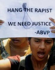 epa03523872 An Indian protester holds a placard during a march against violence towards women and the death of an Indian gang rape victim, in the southern city of Bangalore, India, 04 January 2013. An Indian gang rape victim died on 29 December 2012 in a Singapore hospital where she was being treated for severe injuries. The attack sparked protests expressing anger over attitudes to women in India and calling for changes to the laws on violence against women.  EPA/JAGADEESH NV