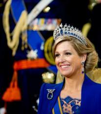 AMSTERDAM - Koningin Maxima glimlacht nadat koning Willem-Alexander de eed heeft afgelegd in De Nieuwe Kerk. POOL ANP ROYAL IMAGES ROBIN UTRECHT
