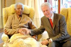 epa03309132 A handout picture relaesed on 17 July 2012 shows former South African President and Nobel Peace Price winner, Nelson Mandela (L) greeting Bill Clinton (R) after he paid Mandela a visit on the eve of  Mandela's 94th birthday at his rural house in Qunu, South Africa, 17 July 2012. Mandela will turn 94 years old on 18 July with many celebrations happening across South Africa.  EPA/PETER MOREY SOUTH AFRICA OUT,  48 HOURS USE ONLY; Mandatory Credit: Peter Morey HANDOUT NO SALES/NO ARCHIVES