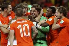 epa04302005 Dutch players celebrate with their goalkeeper Tim Krul (C) after winning the penalty shoot-out of the FIFA World Cup 2014 quarter final match between the Netherlands and Costa Rica at the Arena Fonte Nova in Salvador, Brazil, 05 July 2014. (RESTRICTIONS APPLY: Editorial Use Only, not used in association with any commercial entity - Images must not be used in any form of alert service or push service of any kind including via mobile alert services, downloads to mobile devices or MMS messaging - Images must appear as still images and must not emulate match action video footage - No alteration is made to, and no text or image is superimposed over, any published image which: (a) intentionally obscures or removes a sponsor identification image; or (b) adds or overlays the commercial identification of any third party which is not officially associated with the FIFA World Cup)  EPA/Antonio Lacerda   EDITORIAL USE ONLY