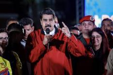 2017-07-31 00:00:00 epa06118363 Venezuelan President Nicolas Maduro (C) celebrates election results after a national vote on his proposed Constituent Assembly at Plaza Bolivar in Caracas, Venezuela, 31 July 2017. The nation-wide vote on the Maduro-backed Constituent Assembly was marred by protests and violence that left at least nine people dead. If initiated, the new assembly would have the ability to bypass congress and rewrite the constitution.  EPA/NATHALIE SAYAGO