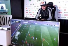 2016-11-06 00:00:00 epa05619911 Danish August Rosenmeier of French club Paris Saint-Germain eSport concentrates on playing while on his way to win the final match in a FIFA 17 video game against Tim Schwartmann (not pictured) of German team Schalke 04 at the eSports torunament Legia eSports Cup 2016 in Warsaw, Poland, 06 November 2016.  EPA/BARTLOMIEJ ZBOROWSKI POLAND OUT