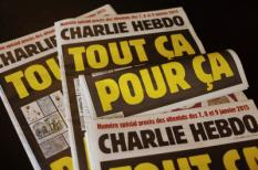 This picture taken on September 1, 2020 in Paris shows covers of French satirical weekly Charlie Hebdo reading 'All of this, just for that,' to be published on September 2 to mark this week's start of the trial for 14 accused in January 2015 jihadist attacks in Paris.  Twelve people, including some of France's most celebrated cartoonists, were killed on January 7, 2015, when brothers Said and Cherif Kouachi went on a gun rampage at the paper's offices.,AFP