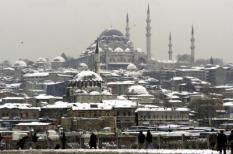 IST02 - 20020107 - ISTANBUL, TURKEY : People cross Galata Bridge to views of snow-covered Rustem Pasa Mosque (front) and Suleymaniye Mosque (rear) in Istanbul on Monday, 07 January 2002. Heavy snowfall and sub-zero temperatures which have paralyzed most of Turkey since last week took four more victims on Monday, bringing the death toll of the harsh winter to at least eleven. EPA PHOTO EPA/KERIM OKTEN