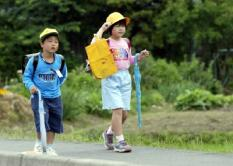 Unidentified children walk to school in a rural village, 60 kilometers east of Tokyo, Wednesday 11 June 2003. According to recent findings many elementary school children suffer from chronic sleep disorders due to attending late-night cram schools and stress at home. Researchers suspect this chronic disorder to be the primary cause of school dropouts in Japan. There were 104,000 high school dropouts in Japan last year according to official reports. EPA-PHOTO/EPA/EVERETT KENNEDY BROWN