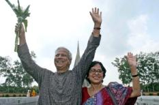 epa00840031 Bangladeshi Professor Muhammad Yunus (L) accompanied by his wife Afrozi wave to the people gathered at the central Shaheed minar, in Dhaka, Bangladesh, on Saturday 14 October 2006. Yunus and the Grameen Bank, of which he is founder and Manager, was awarded the Peace Nobel 2006, as announced by the Peace Nobel Committee in Oslo, Noruega, Friday 13 October 2006. Yunus founded the Grameen Bank, known as the 'Bank of the Poor', in the 70s and in 2006 the financial institution can boast 6.5 million clients, of which 96 percent are women.  EPA/ABIR ABDULLAH RE TRANSMISSION ADDING INFORMATION