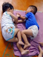 epa000254386 North Korean toddlers sleeping on the floor of a government-run kindergarten in Pyongyang on 06 August 2004. The United Nations World Food Programme says that millions of North Koreans are chronically malnourished. EPA/Gerald Bourke