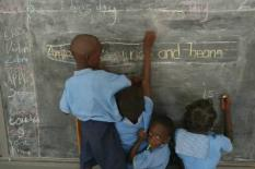 epa000229350 Orphaned children from The Gambia write on a blackboard in a school at the SOS Childrens village in Bakoteh, Gambia Tuesday 06 July 2004. Founded by Austrian Hermann Gmeiner in 1949 the SOS children villages worldwide have grown to become the largest non-governmental child welfare organisation in the world with 1 567 facilities in over 131 countries. The purpose of SOS Kinderdorf International is to help orphaned, abandoned and destitute children. One of the associated problems with HIV/Aids is the alarming number or orphaned and destitute children across Africa because of the disease. The XV International AIDS Conference to be held in Bangkok is about to commence dealing with various issues surrounding the disease and runs from 11-16 July . EPA/NIC BOTHMA