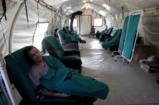 epa01301135 Brazilians are treated at a mobile hospital installed by the Brazilian Air Force on 31 March 2008 in Barra de Tijuca district in Rio de Janeiro, Brazil, where the population affected by dengue Hemorragic Fever (DHF) epidemic are treated. Alone 2008, 54 people have died and another 50,000 have caught the disease.  EPA/ANTONIO LACERDA