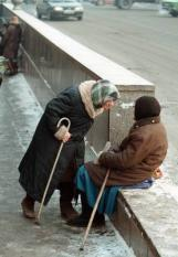SPB01-19990113-ST.PETERSBURG, RUSSIAN FEDERATION: Two elderly women argue about the right to take a place comfortable for begging at the underground pedestrian, 13 January. Many lonely old people the low pensions (the lowest pension in Russia is about 14 dollars amonth) find this the only way to support their life under the continual pressure of rising prices. EPA PHOTO/ANATOLY MALTSEV
