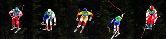 WHISTLER  COMBOFOTO AFDALINGSkiers hangen in de lucht tijdens de afdaling, maandag in Whistler. De afdaling is het koningsnummer en tevens oudste onderdeel bij het alpine wedstrijdskiën. ANP ROBIN UTRECHT